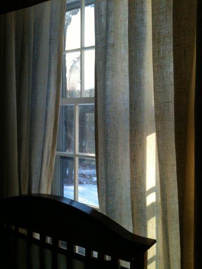 Advent peace curtain over crib