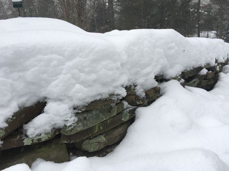 Stone wall under snow