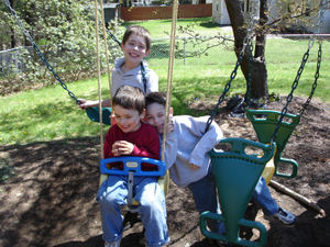 Boys_on_swings_2